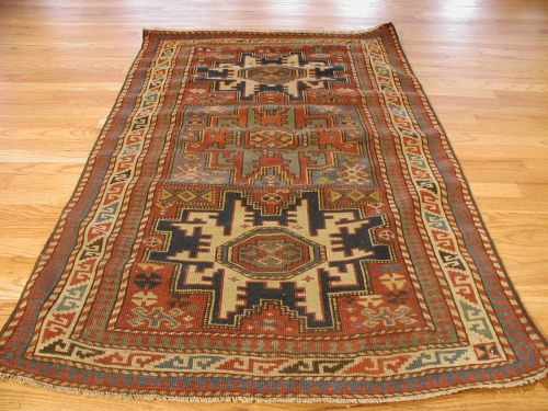 Multicolor And Ivory Kazak Antique Caucasian Rug